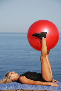 Add variety to rebounding exedrcise workouts using home exercsie balls and bands
